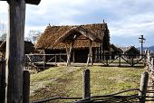 picture of household farm  - Old authentic village with wooden houses and straw on roof - JPG