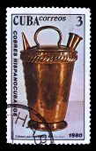 Постер, плакат: CIRCA 1980: A stamp printed in CUBA old pitcher decant