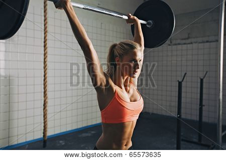 Woman Doing Barbell Lifting poster