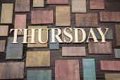 stock photo of thursday  - Wooden letters forming word THURSDAY written on wooden background - JPG