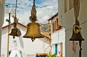 stock photo of himachal pradesh  - Bronze bells in front of Buddhist Temple - JPG