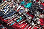 foto of nepali  - Prayer wheels Nepali knives and other souvenirs in the shop at Durbar square in Kathmandu Nepal - JPG