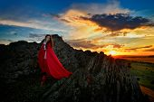 pic of cloak  - beautiful woman with red cloak in the sunset light in spring - JPG