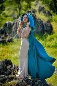 foto of cloak  - beautiful woman with blue cloak posing  outdoor - JPG
