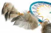 foto of dreamcatcher  - Blue Dreamcatcher with feathers and beads isolated on a white