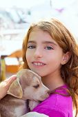 stock photo of dog teeth  - Kid girl smiling puppy dog and teeth braces smiling happy - JPG