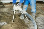 picture of floor covering  - Plasterer at indoor floor concrete cement covering - JPG