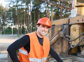 pic of heavy equipment operator  - Portrait of a positive driver of construction equipment - JPG