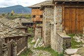 image of old stone fence  - Old building made of stone roof tiles in Bulgaria - JPG