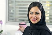 image of hijabs  - Arabian Businesswoman wearing hijab with her boss in background - JPG