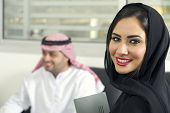 picture of hijabs  - Arabian Businesswoman wearing hijab with her boss in background - JPG