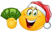 foto of ball cap  - Yellow ball wearing Santa hat and holding dollar bills - JPG