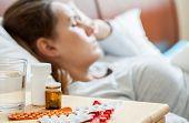 picture of sick  - Horizontal view of sick woman sleeping in bedroom - JPG