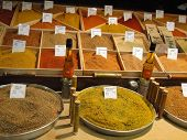 picture of avignon  - Fresh spice olive oil and special mixtures on display Les Halles Avignon France - JPG