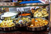 picture of buffet lunch  - Buffet lunch in Turkish restaurant of bulgur coos coos peppers stews soup and meat dishes near Pergamum Turkey - JPG