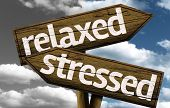 picture of stress  - Relaxed x Stressed creative sign with clouds as the background - JPG