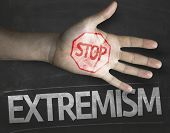 image of extremist  - Educational and Creative composition with the message Stop Extremism on the blackboard - JPG