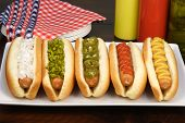 picture of hot dog  - hot dogs on a nice table setting rich textures colors and flavors - JPG