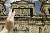 picture of bolivar  - Hand takes a picture of the Bogota Cathedral - JPG