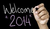 pic of reveillon  - Welcome 2014 hand writing with a white mark on a transparent board - JPG