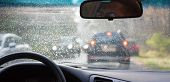 stock photo of car-window  - traffic congestion wheel car rain bad weather - JPG