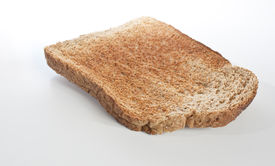 stock photo of whole-grain  - a single slice of brown toast isolated on white - JPG