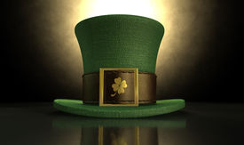 picture of shamrocks  - A green material leprechaun hat with a brown leather band emblazened with a gold shamrock and buckle on a dark spotlit background - JPG