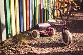 foto of tricycle  - Deserted rusty children - JPG