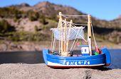pic of figurine  - Blue Fishing Boat Figurine near the Water - JPG