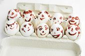 stock photo of human egg  - Funny eggs sitting in the tray - JPG
