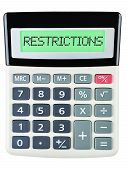 foto of restriction  - Calculator with RESTRICTIONS on display on white background - JPG