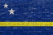 stock photo of curacao  - flag of Curacao painted on brick wall - JPG