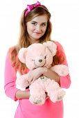 stock photo of teddy  - beautiful smiling girl in pink a dress with a teddy bear - JPG