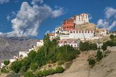 pic of jammu kashmir  - Thiksay monastery with view of Himalayan mountians and blue sky in background Ladakh Jammu and Kashmir India - JPG