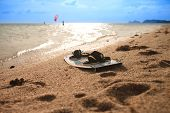 stock photo of kites  - kitesurfing board at the beach with kite in the background - JPG