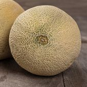 picture of muskmelon  - Fresh melons on old wooden background - JPG