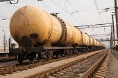image of fuel tanker  - Cargo train with oil tanker cars on the freight station - JPG