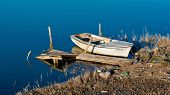 stock photo of old boat  - Old fishing boat on the shore - JPG