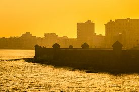 image of malecon  - Colorful surise in Havana with a view of the malecon seawall and the city skyline - JPG