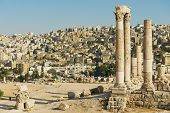 image of amman  - View to the ancient stone columns at the Citadel of Amman with the Amman city at the background in Amman - JPG