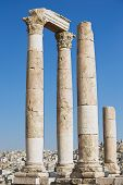 picture of amman  - View to the ancient stone columns at the Citadel of Amman with the Amman city at the background in Amman - JPG