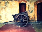 stock photo of oxen  - Old wooden ox cart or horse cart - JPG