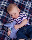 pic of little boys only  - Little boy sitting on soft textile and holding his plush toy - JPG
