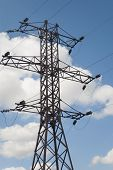 picture of power transmission lines  - Electric pylons power transmission line on sky background - JPG