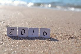 foto of starfish  - New year 2016 sign with seashells - JPG