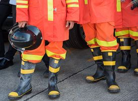 stock photo of firemen  - hand hold fireman hat when waiting for work - JPG