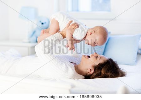 Baby And Mother At Home