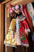 foto of oddities  - Dolls from a puppet theater weighing on a wall - JPG