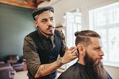 Постер, плакат: Bearded Man Getting Haircut By Barber