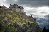 Dramatic lighting as storm clouds gather around Edinburgh Castle in Scotland